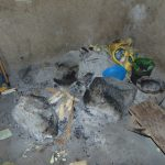 The Water Project: Bukhaywa Community, Shidero Spring -  Current Water Source Stone Stove