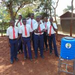 The Water Project: Ikumba Secondary School -  Boys Pose With Handwashing Station