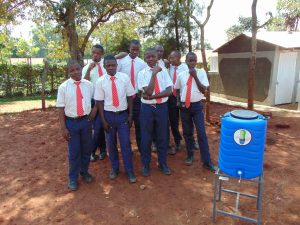 The Water Project:  Boys Pose With Handwashing Station