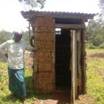 The Water Project: Bukhaywa Community, Ashikhanga Spring -  Women Next To Latrine