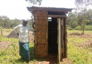 The Water Project:  Women Next To Latrine