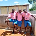 The Water Project: Irovo Orphanage Academy -  Boys Pose In Front Of Latrines