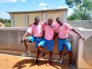 The Water Project:  Boys Pose In Front Of Latrines