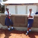 The Water Project: Ikumba Secondary School -  Girls In Front Of Latrines