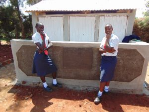 The Water Project:  Girls In Front Of Latrines