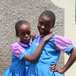 The Water Project: Kapchorwa Primary School -  Girls Pose Next To The Latrines