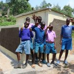 The Water Project: Kapchorwa Primary School -  Boys Outside Their New Latrines