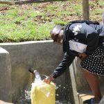 The Water Project: Shamiloli Community, Kwasasala Spring -  Field Officer Mary Afandi Fills Up