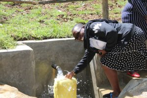The Water Project:  Field Officer Mary Afandi Fills Up
