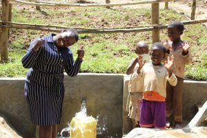 The Water Project:  Team Leader Catherine Chepkemoi With Children