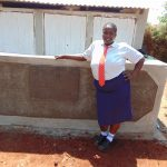 The Water Project: Ikumba Secondary School -  Student In Front Of Latrines
