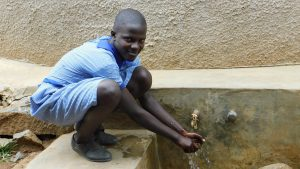 The Water Project:  Student At The Tank