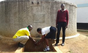 The Water Project:  Asenga Left And Enos Right With Student