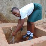 The Water Project: Kwirenyi Secondary School -  Nicorine Shitamu At Rain Tank