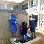 The Water Project: Eshisenye Girls Secondary School -  Field Officer Jacklyne Chelagat Between Everline And Mildred