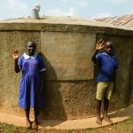 The Water Project: Shina Primary School -  Students At Back Of Rain Tank