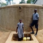 The Water Project: Emmaloba Primary School -  Mary With Another Student At The Rain Tank
