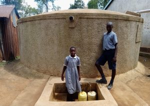 The Water Project:  Mary With Another Student At The Rain Tank
