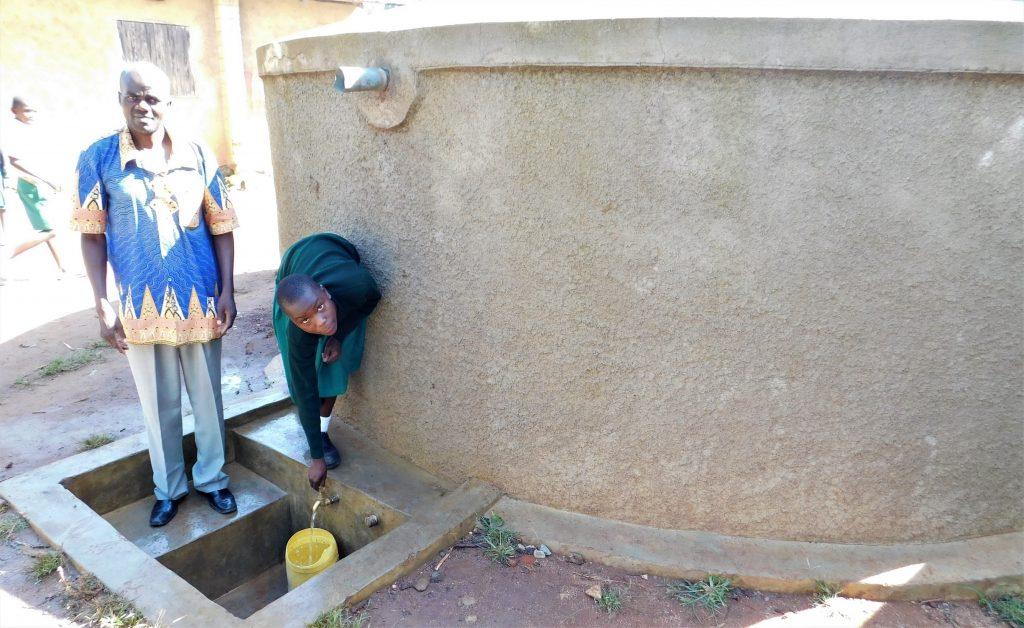 The Water Project : 4-kenya18047-head-teacher-mashishia-with-vanessa