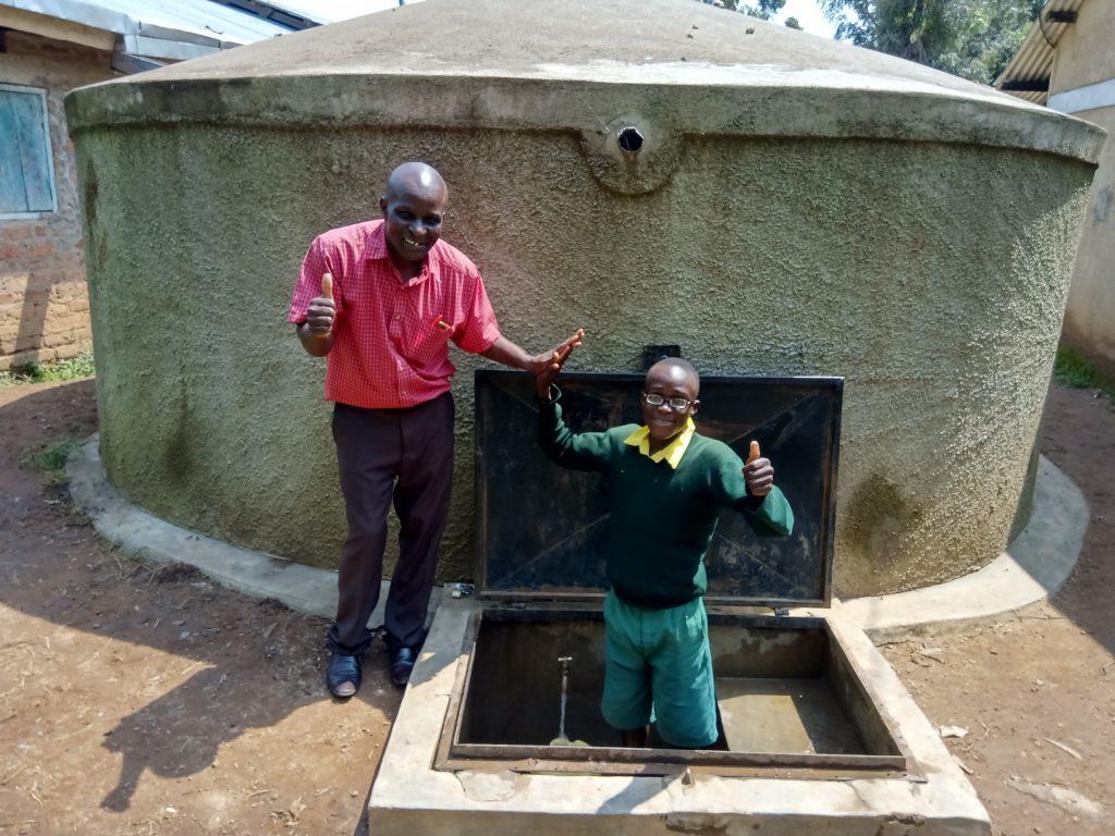 The Water Project : 4-kenya18049-head-teacher-aggrey-maloha-with-abraham