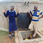 The Water Project: Kamuluguywa Secondary School -  Rebecca And Mr Nambisia At The Rain Tank