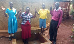 The Water Project:  Centrine Field Officer Betty Chrisantus And Mr Anunda