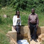 The Water Project: Lwenya Community, Warosi Spring -  Field Officer Laura Alulu With Mr Luvembe