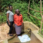 The Water Project: Jivovoli Community, Wamunala Spring -  Beatrice With Field Officer Laura Alulu