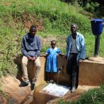 The Water Project: Jivovoli Community, Gideon Asonga Spring -  Field Officer Ian Nakitare With Samuel And Natasha