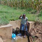 The Water Project: Burachu B Community, Shitende Spring -  Thumbs Up From Lucy