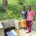 The Water Project: Indete Community, Udi Spring -  Pamela Muyonga With Field Officer Jonathan