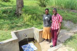 The Water Project:  Pamela Muyonga With Field Officer Jonathan
