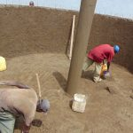The Water Project: Ikumba Secondary School -  Cementing Inside The Tank