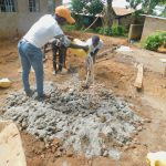 The Water Project: Makunga Primary School -  Mixing Cement With Gravel