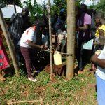 The Water Project: Mutao Community, Kenya Spring -  Leaky Tin Handwashing Training
