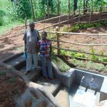 The Water Project: Buhayi Community, Nasichundukha Spring -  Spring Landowner Joseph Sifuna Wekesa And Field Officer Jemmimah