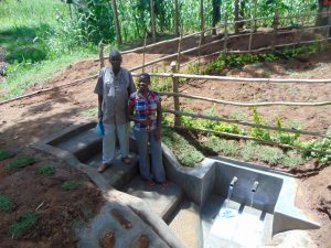 The Water Project:  Spring Landowner Joseph Sifuna Wekesa And Field Officer Jemmimah