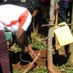 The Water Project: Mutao Community, Kenya Spring -  Demonstrating The Leaky Tin