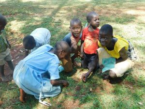 The Water Project:  Children Enjoying Delicious Termites After Training