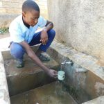 The Water Project: Muyere Secondary School -  Alvine Kakai Gets A Drink