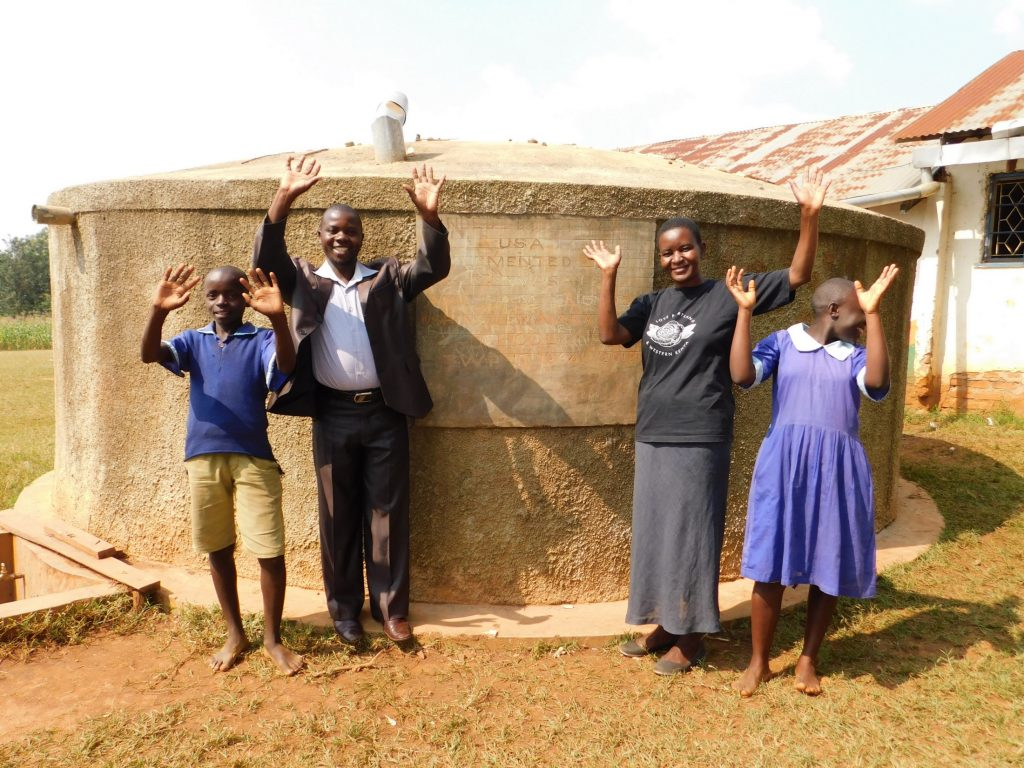 The Water Project : 5-kenya18041-mr-ambani-field-officer-rose-and-students