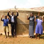 The Water Project: Shina Primary School -  Mr Ambani Field Officer Rose And Students