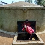 The Water Project: Jidereri Primary School -  Mr Maloha Takes A Drink From The Rain Tank