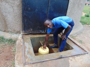 The Water Project:  Student Fetches Water From The Rain Tank