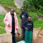 The Water Project: Chandolo Community, Joseph Ingara Spring -  Joseph With Field Officer Erick Wagaka And Stacy