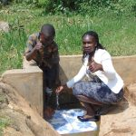 The Water Project: Lwenya Community, Warosi Spring -  Timothy With Field Officer Laura