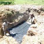 The Water Project: Shihingo Community, Inzuka Spring -  Spring Foundation Is Laid