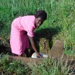 The Water Project: Emurumba Community, Makokha Spring -  Grace Aswani Fetches Water From Makokha Spring