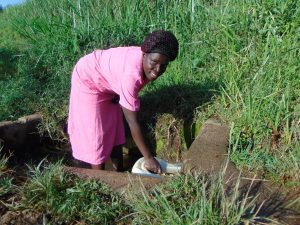 The Water Project:  Grace Aswani Fetches Water From Makokha Spring
