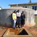 The Water Project: Shitoli Secondary School -  Field Officer Laura Alulu With Barbra And Josephine
